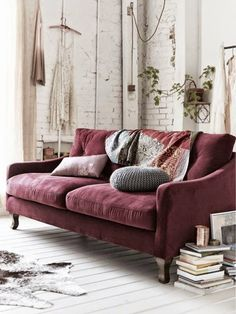 A deliciously comfy looking purple couch in this relaxed living room.