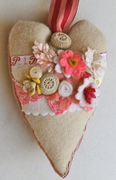 felt heart.  When I was about 8, my mom and I made something like this to give as Valentines.
