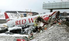 An aircraft wreckage lies next to a motorway near Moscow's Vnukovo airport