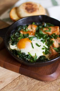 Baked Eggs with Wilted Spinach and Salmon | http://saltandwind.com