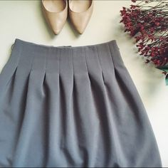 H&M A-Line Skirt Adorable and girly skirt!                                                      • a closet favorite! belt missing, there are 2 loops on side.                                                                                    • due to H&M sizing, it fits like a 2. H&M Skirts A-Line or Full