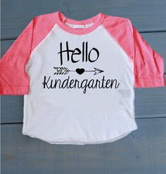 Such an adorable shirt for your little ones first day of school! If you would like a different grade other than Kindergarten, let me know in the notes section at checkout! ------------------------------------------------------------------------------------------------ Available on American Apparel poly-cotton 3/4 sleeve Raglan (color options in pictures). If you would like this design on one of our other shirt styles, send me a custom request!  SEE PICTURES FOR SIZE CHARTS…