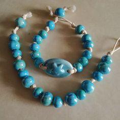 Blue ceramic bracelet.