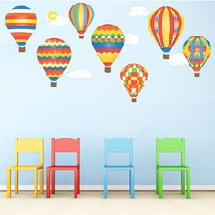 7 Hot air balloons and 5 clouds removable & reusable wall decals. Red, blue, green and yellow balloons in geometric, stripes and chevron designs. A beautiful way to decorate a nursery, bedroom or play