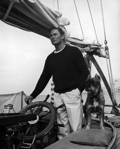 Errol Flynn proving style is equal amount clothes as it is dogs and boats