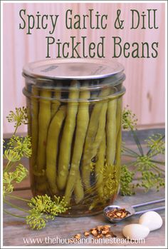 These spicy garlic and dill pickled beans are the perfect way to preserve summer's bounty of green beans to enjoy all year long. Great in a Bloody Mary, better in a Caesar! Spicy Green Beans, Pickled Green Beans, Can Green Beans, Spicy Pickled Beans, Spicy Pickled Vegetables Recipe, Pickled Sausage, Pickled Garlic, Garlic Dill Pickles, Pickles