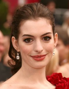Pin for Later: 16 Sexy Pouts That'll Make You Forget About Kylie Jenner's Lips Anne Hathaway Anne Hathaway's natural wide smile and big lips are just a few reasons why this movie star is a beauty stunner.