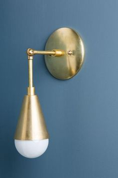 This wall sconce with cone is made with all brass and can be adjusted 180 degrees. The sconce extends 7 inches from the wall and is 12 inches long from the top of the plate to the bottom of the bulb.