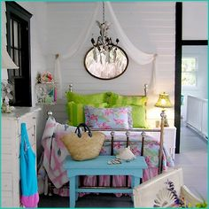 I love this Jane Coslick design.  Maybe for the sleeping porch or one of the bedrooms, chandlier and mirror and canopy swag and colors!