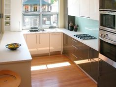 Same size and shape as my kitchen. Wonderful idea for layout, definitely thinking of adding multiple ovens in the exact same spot.