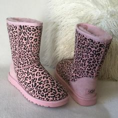 """UGG BRAND NEW suede pink leopard print boots UGG BRAND NEW suede bubble gum pink leopard print boots    Beautiful pink interior fur and soles. Little scuff as pointed out at bottom trim otherwise wonderful condition never worn.  Measures 8 1/2"""" tall   Women's size 5 UGG Shoes Winter & Rain Boots"""