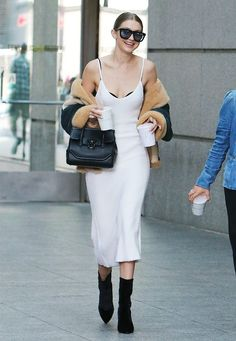 Gigi Hadid proves that white dresses aren't just for the hottest days of the year- winterise your looks with a shearling jacket and ankle boots whenever you are ready.
