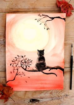 This beginner-friendly watercolor tutorial will show you how to paint the silhouette of a black cat watching a harvest moon.