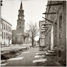 St. Michael's Episcopal Church in Charleston, South Carolina, in 1865 following bombardment of the city during the Civil War. From photographs of the Federal Navy and seaborne expeditions against the Atlantic Coast of the Confederacy, 1863-1865.