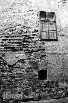 Aged wall with window Photograph