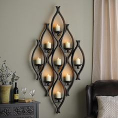 Add a unique piece of decor to you home with the 9 Pillar Wall Candleholder! It will create a warm, soft glow when you light the candles.