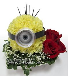 Minion Flower Art Arrangement - Tell her she is ONE IN A MINION with this minion look-a-like flower art arrangement. Unique Flower Arrangements, Funeral Flower Arrangements, Funeral Flowers, Unique Flowers, Amazing Flowers, Cut Flowers, Bd Design, Fleur Design, Floral Design