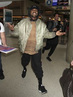 Musician/designer/Kardashian champion Kanye West flashed a big smile while he walked through Los Angeles International Airport. Adidas Ultra Boost Shoes, Alpha Industries Ma 1, Kanye West Style, Yeezy Outfit, Brooklyn Beckham, West Los Angeles, Child Models, Famous Brands