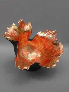 """Kay Lynne Sattler, """"House of the Sun Series IV"""" Coiled clay, pit fired, gilded with copper leaf."""
