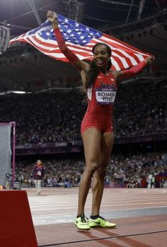 Yay for Sanya, jumbo fan!     Sanya Richards-Ross wins 400 meters; first gold for U.S. in track at London Games