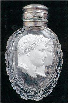 Toegepaste en symbolische functie van een parfumflesje
