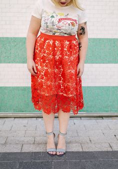 This fashion blogger is ready for a colorful Summer with a graphic tee, striped chunky heels, and a bright lace skirt!