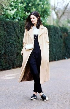 Transition overalls to fall by layering it over a knit and slipping on a camel coat. // #StreetStyle