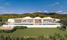 A white, low-slung dwelling has a rippled roofline, which Mateus designed with walls that slide open to fuse the interiors with a patio. Inside, an arched ceiling frames the pool. Natural Swimming Pools, Outdoor Swimming Pool, Villa Design, House Design, Hotel Ibiza, Ibiza Spain, Swimming Pool Designs, Rooftop Terrace, Flat Roof