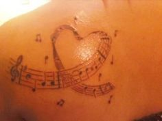 My first tattoo. its the music notes to you are my sunshine. hehehehe Photos from Hoshi Isabelle (*~Belle-Bonn~*~Sister-Lust~*) on Myspace