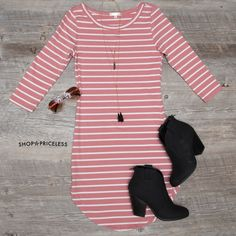 - Details - Size Guide - Model Stats - Contact It's greased lightning! This mauve striped Sandy Basic Dress features a lightweight, knit fabric with stretch. Scoop neck front, three-quarter-length sle
