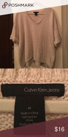 Sweater Calvin Klein rolled short sleeve sweater with scoop neck. Slightly longer in back. Fabric is 53% cotton, 40% acrylic and 7% polyester.  Oatmeal color. Calvin Klein Jeans Sweaters