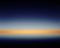 The black line is the edge of the lake, miles away from where Murray Fredericks was standing. Working in such a space, he was keenly aware of variations in hue. In this shot, taken just after dusk, he was fixated on the subtle transition of orange to deep blue.