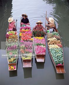 A group of four women market traders in boats laden with fruit and flowers, Damnoen Saduak floating market, Bangkok, Thailand, Southeast Asia, Asia – Image © Robert Harding Images / Masterfile.com: Creative Stock Photos, Vectors and Illustrations for Web, Mobile and Print