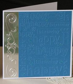 A card for the boys - embossed border and birthday embossing folder.