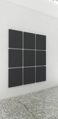"""Alan Charlton, Grid painting 3 x 3 2009 """"Alan Charlton is an artist who makes a gray painting""""—so goes the artist's self-stated epigram. In the 1970s, Charlton famously decided to make monochromatic paintings using only shades of gray"""