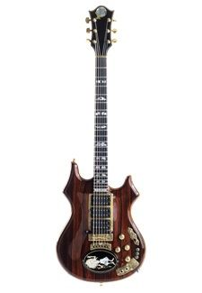 "Among Jerry Garcia's most well-known electric guitars is the unique instrument dubbed ""Rosebud."" Built for Garcia by luthier Doug Irwin, who had previously worked for Alembic guitars, it was the fourth guitar that Irwin had made for the Grateful Dead's charismatic vocalist and multi-instrumentalist.   Garcia first played the guitar in 1989, and it was his main stage guitar until 1993."