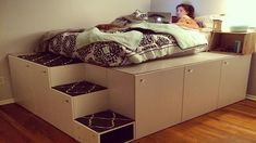 Several IKEA cupboards transformed into the most practical bed in the world