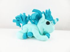 Clay unicorn with a turquoise mane and tail sculpture figurine Polymer Clay Sculptures, Sculpture Clay, Mane N Tail, Making Out, Smurfs, Sculpting, Unicorn, Turquoise, Whittling