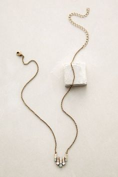 Deco Tilt Necklace - anthropologie.com #.  An example of what I like in using old jewelry/vintage pieces and recreating.