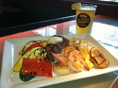 Its surf & turf for tonight's Mash Up - A mixed grill featuring 4oz steak, shrimp, pineapple and summer vegetables with a Boulevard Brewing Company Wheat Ale for $15.