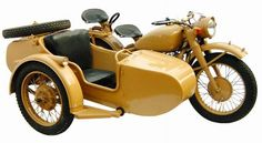 Mustard colored URAL motorcycle with side car. Awesome.