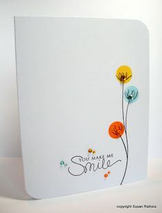 Love those little color bursts behind the sketchy flower - could possibly get a similar effect with daubers?