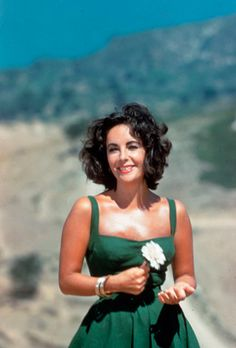 Liz Taylor looking wonderful, no cleavage, no raunchy poses.  Stars knew how to be alluring back then without dressing like pole dancers.
