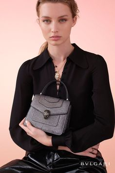 Serpenti Forever crossbody bag in charcoal diamond metallic karung skin. Snakehead closure in light gold plated brass decorated with glitter charcoal diamond and shiny black enamel and black onyx eyes.