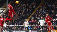 Albert Adomah scores a first-half  header in Middlesbrough's 2-0 away win at Fulham in the Championship