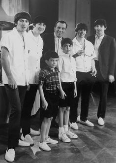 Beatles with Ed Sullivan and children