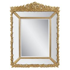 Beveled wall mirror with a leaf-inspired metal frame.     Product: Wall mirror   Construction Material: Metal and m...
