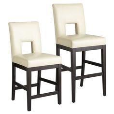 The traditional 1930s Parsons chair takes an ultra-modern turn with the addition of a bold cutout and high-rise legs. The comfort factor, however, hasn't changed. Durable faux leather in creamy ivory is hand-stretched tight over 100% foam cushioning on back and seat for maximum sit-ability. Lightly tapered hardwood legs and base provide stability and contrast. No generation gap here.