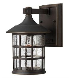 Hinkley Lighting 1800OZ Outdoor Sconce Lighting Freeport 1-Light Oil Rubbed Bronze does more than just the audacity of its design but also gives a spotlight to your front yard with a traditional look. The oil rubbed bronze finish of this top seller item adds to this, as colors such as this are generally known to complement the outdoors.  Call 888-752-5448 and Get the Lowest Price in the Market.