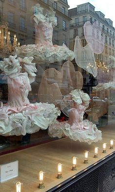 Elaborate ballet costumes with full tutus in a window display